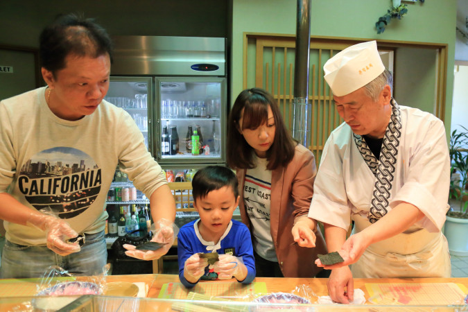 Making a decorated sushi with a sushi master.